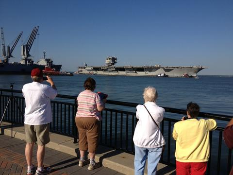 The USS Enterprise arrives to the Newport News shipyard early Thursday.