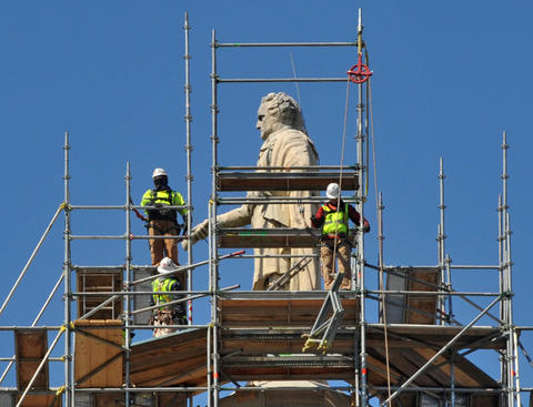 As restoration work on the Washington Monument continues, the scaffolding has reached George Washington's head. Workers are re