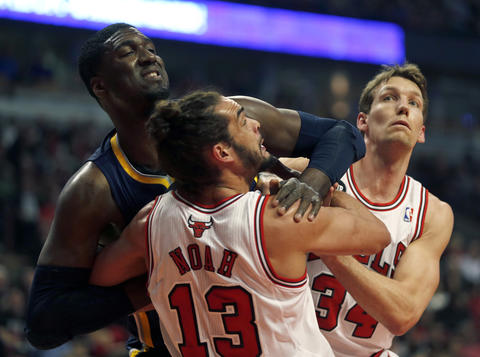Joakim Noah and Mike Dunleavy battle for rebounding position against the Pacers' Roy Hibbert in the first quarter.