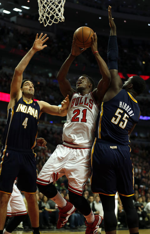 Jimmy Butler shoots between the Pacers' Luis Scola and Roy Hibbert during the 3rd quarter.