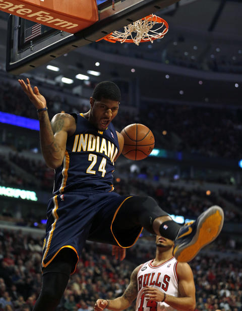 The Pacers' Paul George reacts to dunking in the first quarter.