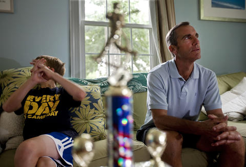 """Bradley and Jim Garner sit together on the couch at their Hilton home in early August. Baseball has always been a shared love and the two never miss an opportunity to play catch in the yard. Even as his short-term memory wanes, Jim says his knowledge of the game is sharp. """"Like if I go to Bradley's baseball practice and I help with the drills, I'm not going to forget the drillsÑI've been doing those for a hundred years,"""" he said. """"And I'm not going to forget the rules of baseball, but that's just the way it is."""""""