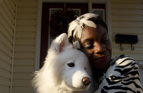 Newport News resident Denna Williams hugs her service dog, Diamond, who will soon be retired and adopted by a new family.