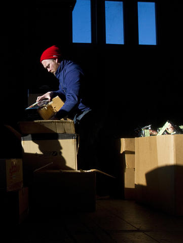 Greg Womble sorts toy deliveries at the U.S. Marine Corps Reserve Toys for Tots drive on Friday in Newport News.