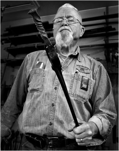 Steve LaPaugh the Warwick Forge Blacksmith, Steve works inside his forge all year crafting and repairing items out of steel.
