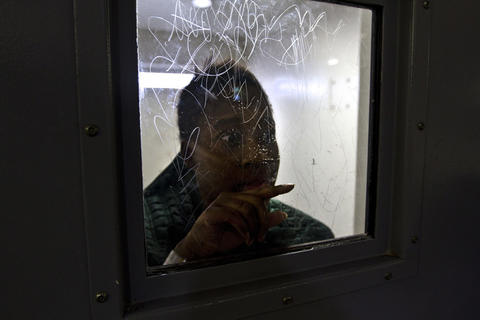 Jessica Butts 32 is looking through her door window on the cell block...Hampton Roads Regional Jail in Portsmouth houses hundreds of mentally ill from the peninsula. The special units sometimes hold mentally ill in solitary. There are anywhere from 6 to 12 inmates on suicide watch at any given time at HRRJ. Staffed primarily by law