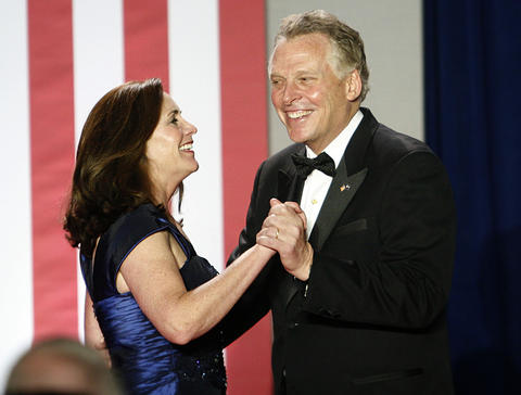 An Inaugural Ball was held for Governor-elect Terry McAuliffe at the Half Moone Cruise Center on January 5, 2014. The theme of the celebration was a salute to the military and veterans. Governor-elect McAuliffe dances onstage with his wife, Dorothy.