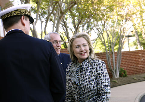 Secretary of State Hillary Clinton arrives at NATO Allied Command Transformation (ACT) HQ on Tuesday, April 3, 2012.  She is being greeted in Norfolk here by left, General Stephane Abrial, French Air Force, ACT Commander and Ambassador Ravic Huso, U.S. Ambassador to NATO ACT.
