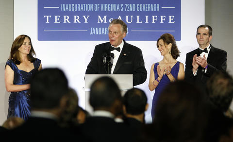An Inaugural Ball was held for Governor-elect Terry McAuliffe at the Half Moone Cruise Center on January 5, 2014. The theme of the celebration was a salute to the military and veterans. Here, Governor-elect McAuliffe is joined on stage by his wife, Dorothy, left, and Pam and Lt. Governor-elect Ralph Northam.