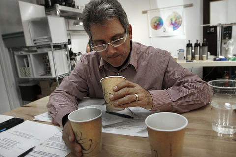 Traveling from Ft. Lauderdale to take the class, Patrick Evans samples three coffees brewed with different coffee to water ratios. He is taking a certification class at Williamsburg Coffee and Tea.