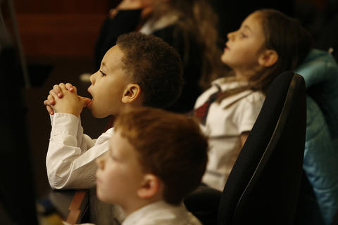 As part of a College of William and Mary law School Mock trial, first and second grade students from Providence Classical School became jurors at the  trial of Goldilocks, who was charged with breaking and entering and  destruction of property. The children listen attentively to the testimonies.