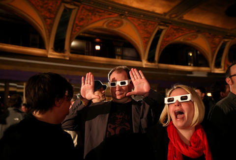 Fans have fun while wearing their 3-D glasses prior to Kraftwerk taking the stage at the Riviera Theatre in Chicago.