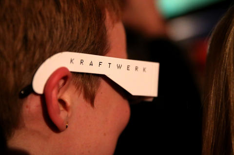 A woman wears her 3-D glasses prior to Kraftwerk taking the stage at the Riviera Theatre in Chicago.
