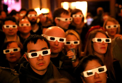 Fans wear their 3-D glasses while taking in a performance by Kraftwerk at the Riviera Theatre in Chicago.