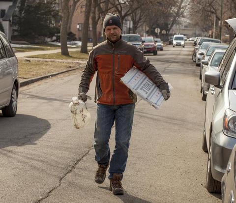 Jim walks down W. Argyle Street towards the soon to be filled pothole.