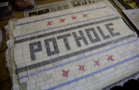 Close-up view of the tile art that Jim Bachor creates in his basement studio to fill selected Chicago potholes. A piece of cheese cloth is glued to the tiles to hold them in place until they can be set in concrete.