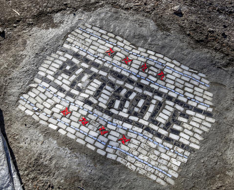 A view of the finished pothole transformed into a mosaic work of art.