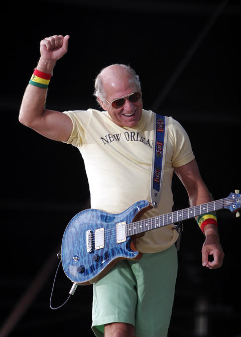 "Jimmy Buffett (Sept. 4-5, 2005): Fans outfitted in Buffett-approved ""Parrothead"" gear - grass skirts, straw hats, beads and coconut bras (and that was just the guys) - invaded Wrigleyville, while the headliner padded around barefoot onstage in lime-green shorts and a Cubs jersey. He covered three songs by Chicago folk legend Goodman, as well as such introspective odes to revelry as ""Why Don't We Get Drunk"" and ""Cheeseburger in Paradise."" - Greg Kot"