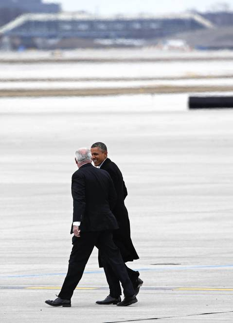 President Barack Obama walks with Illinois Gov. Pat Quinn at O'Hare International Airport, in Chicago. The President was in town to attend fundraisers for the Democratic National Committee.