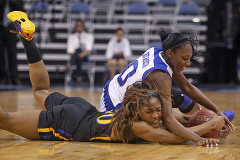 Hampton's Malia Tate-DeFreitas, right, and Coppin State's Kyra Coleman battle for a loose ball during Saturday's championship game of the 2014 MEAC tournament at Norfolk Scope Arena.