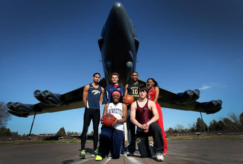 The athletes of the year from track, basketball, wrestling and swimming pictured in front of a B-52 Stratofortress on display at Langley Air Force Base. The B-52 is a long range bomber that has been in service since the 1950's.