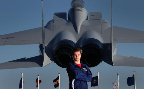 Staff Photo Of The Week: March 22-March 28, 2014   Grafton swimmer Jonathan Spires is photographed with an F-15 Eagle on display at Langley Air Force Base. The F-15 is a twin-engine, all-weather tactical fighter that went into service in the 1970's.