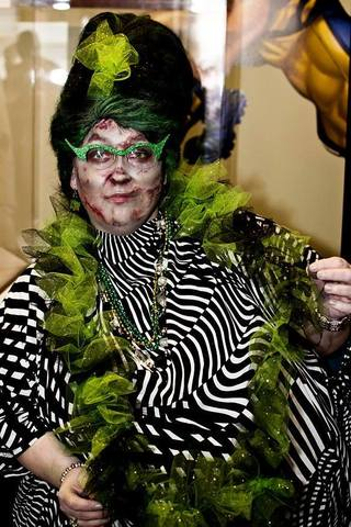 """We were at Zombie Gras 2013 at Geppi's Entertainment Museum. My costume is in honor of the Baltimore hon [pictured], and my husband's [see next photo] was a tribute to the Ravens players we lost. ...""-- The Mones"