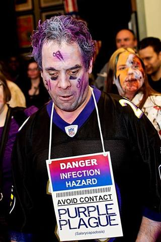 """We were at Zombie Gras 2013 at Geppi's Entertainment Museum. My costume is in honor of the Baltimore hon [see previous photo], and my husband's [pictured] was a tribute to the Ravens players we lost ..."" -- The Mones"