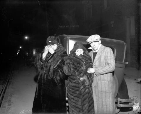 Mrs. Mary Paleones, from left, Mrs. Josephine Palisaitis and her son William Palisaitis at the 22nd Street tunnel disaster on April 13, 1931. Laborer John Paleones was one of the eleven men killed in the sanitary tunnel fire, while Dominick Palisaitis survived in an air chamber 35 feet below ground.