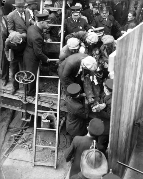 Lt. Conrad Wynne, of squad 10, is pulled out of the smoke-filled elevator shaft of the sanitary district tunnel on April 14, 1931.