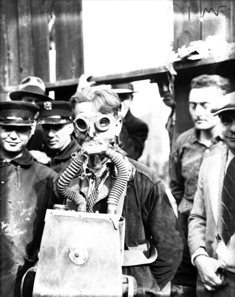Fireman Irving Strom, 28, volunteered to use a newer type mask delivered from the Oak Park fire department. According to Tribune reports, Strom made seventeen trips into the tunnel and brought up six bodies and one person alive. Editors note: this image is partially damaged.