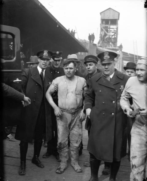Laborers are put into ambulances and sent to St. Anthony's Hospital after being rescued from the tunnel fire. Fifty-four firefighters and laborers were injured and treated at the hospital.