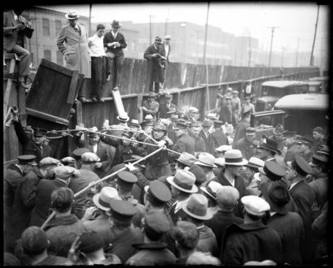 A crowd of firefighters and workers gathers at the unfinished sanitary district tunnel at 22nd and Laflin Streets in Chicago to help with the rescue mission.