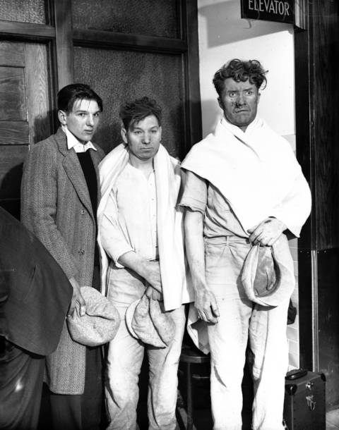 Laborer Dominick Palisaitis with son William, left, and laborer Peter Rakulski at St. Anthony's Hospital on April 14, 1931. Palisaitis and Rakulski were part of the 16 men who were trapped over night in an air chamber 35 feet below the surface.