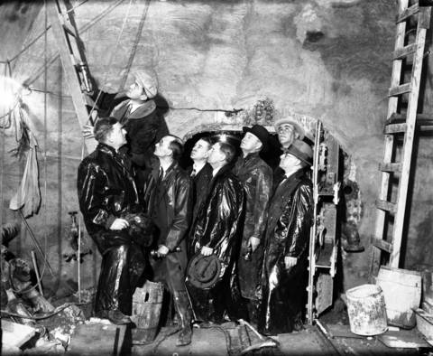 On April 15, 1931, investigators from the coroner's jury look at the spot where the fire started in the sanitary district tunnel below 22nd Street.