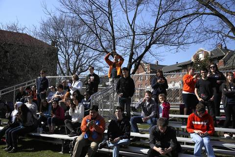 A crowd gathers as the University of Illinois' Alma Mater sculpture is returned to campus after restoration work.