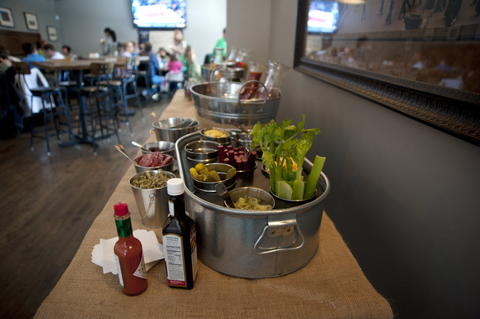 The build your own Mimosa or Bloody Mary bar includes a variety of juices, fruits and meats for assembling a brunch beverage at Commonwealth Tavern