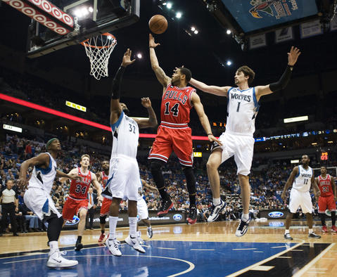 D.J. Augustin takes a shot over the Timberwolves' Ronny Turiaf in the second quarter at Target Center.