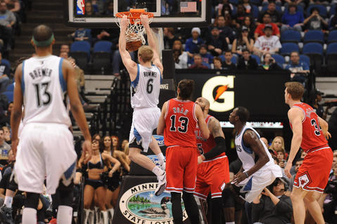 The Timberwolves' Robbie Hummel dunks the ball in the first quarter.