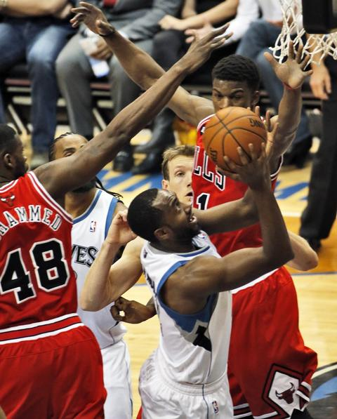 The Timberwolves' Luc Richard Mbah a Moute drives against the Bulls.
