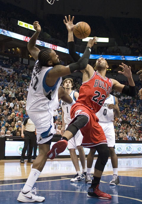 The Timberwolves' Ronny Turiaf blocks a shot by Taj Gibson in the second quarter.