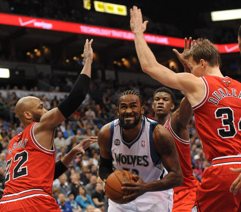 The Timberwolves' Ronny Turiaf pulls up for a shot against Taj Gibson in the fourth quarter.
