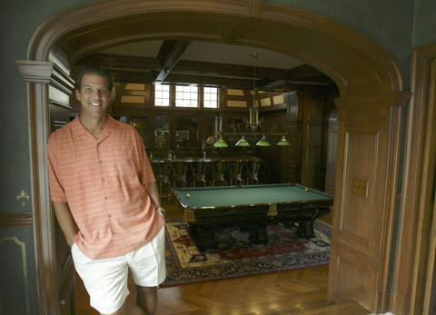 Steve Bisciotti poses inside his home.