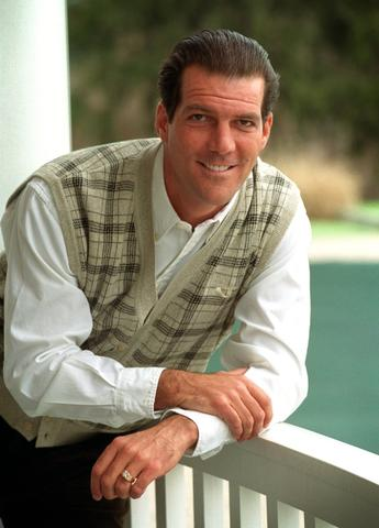 Steve Bisciotti poses for a photo after becoming a minority owner of the Ravens.