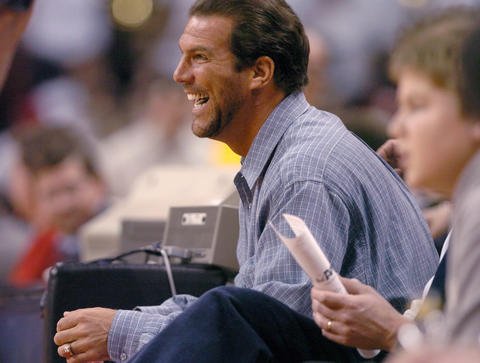 Steve Bisciotti sits courtside at a Maryland basketball game at Comcast Center.