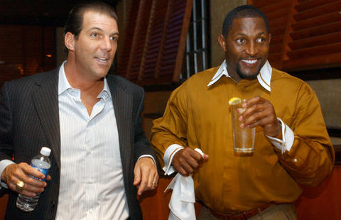 Steve Bisciotti attends a private party with Ray Lewis at the linebacker's Full Moon Bar-B-Que restaurant in Canton.