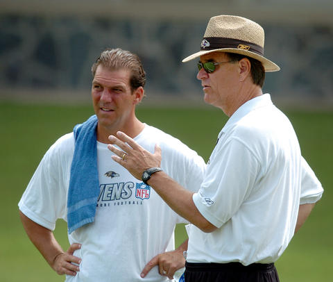 Steve Bisciotti listens to coach Brian Billick during training camp.