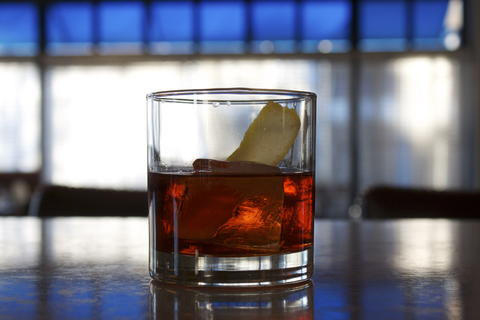 Price: $13  Ingredients: Yellow Chartreuse, Amaro Meletti, Aperol Buffalo Trace Bourbon. Spirits are combined in equal proportions and left to age in a oak cask for 2 months. Served over one large cube with a lemon swath.  This small drink is packed with complexity and is for those serious about sipping. The barrel-aging is a signature of Max Fish in Glastonbury.