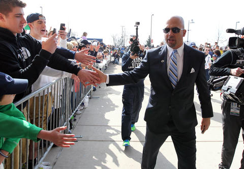 Penn State Nittany Lions head coach James Franklin shakes hands with fans prior to the blue white spring game at Beaver Stadium.