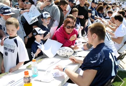 Penn State Nittany Lions quarterback Michael O'Connor (15) signs an autograph prior to the Blue White spring game at Beaver Stadium.
